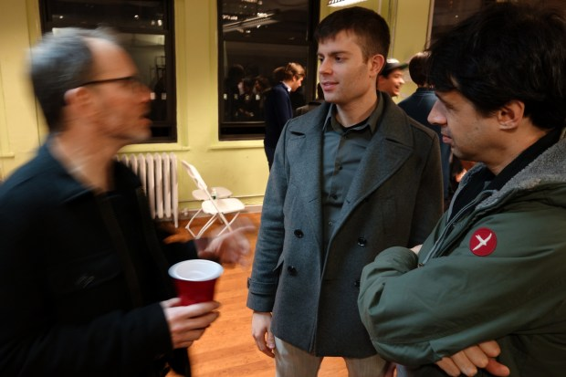 Hardware makers and enthusiasts chatting after the presentations.
