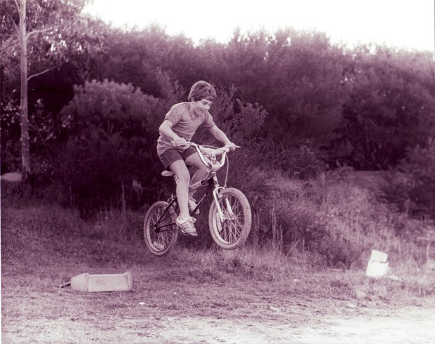 Getting some huge, gnarly air as an 8-year-old using a bike ramp I built myself. Note: I didn't even injure myself ... this time.