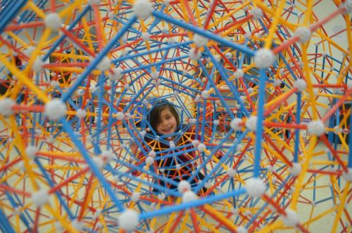 At Einstein's Workshop, Sofia Houh peers through the center of the expanded 120-cell created using Zome in a workshop with participants from as far away as Stamford, Conn., 180 miles away.