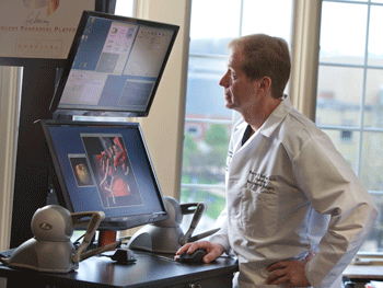 Dr. Warren Selman, M.D. with the haptically enabled Surgical Rehearsal Platform (SRP) from Surgical Theater