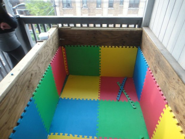 Pad your wooden box with interlocking foam pads.