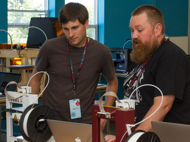 Matt Stultz (right) shows James Christianson the Up/Afinia software toolchain.