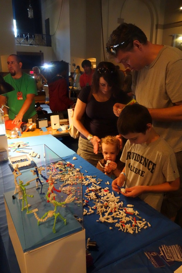 An entire family tinker with Wayne Losey's ModiBot DIY action figures.