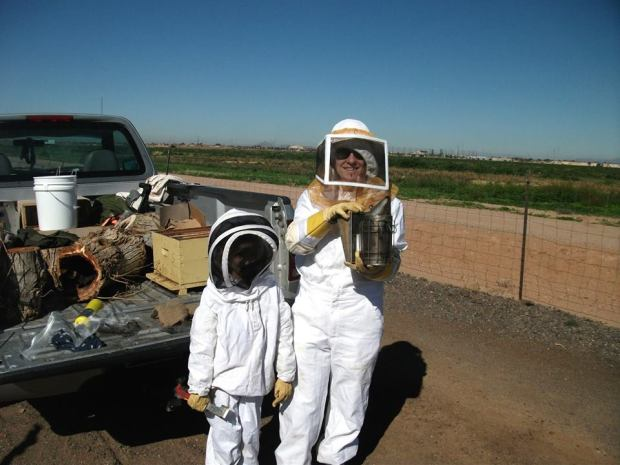 Amy and her daughter know how to dress for bees-ness.