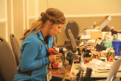 Catherine Hess building a SumoBot at RobotsConf.