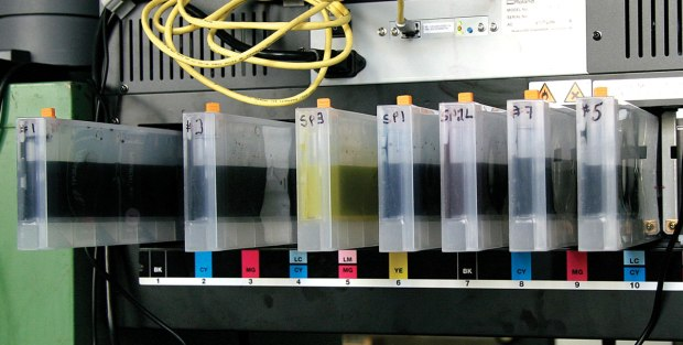 """Test carts are filled with inks that Cone made in his studio prior to production. The printer is a 110"""" Roland solvent printer that has been adapted for use with the pigment inks."""