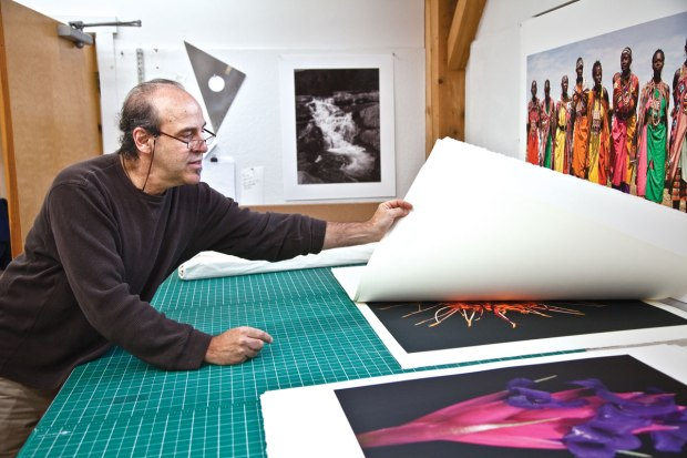 Jon Cone flips through his large scale prints.