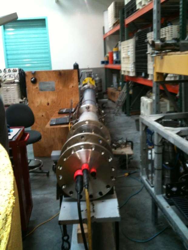 The spar from the MBARI wave energy converter project resting horizontal on a test bench