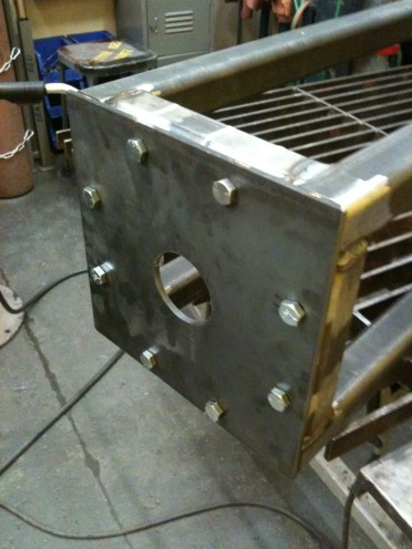 Square plate welded to the end of each frame.