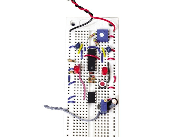 (G) In this breadboarded circuit, the red and black wires supply 9VDC from a battery while the gray wires go to the loudspeaker.
