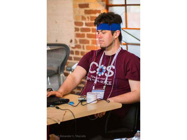 UCSD researcher Grant Vousden-Dishington, working with OpenBCI at NeuroGaming 2014.