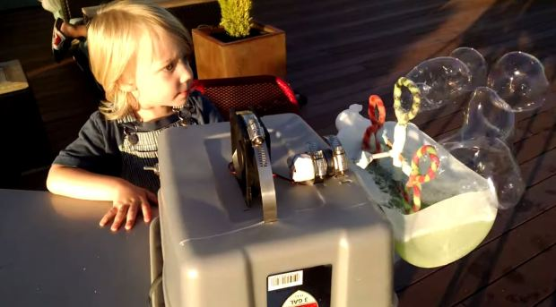drenehtsral's Makeshift Bubble Machine uses a CPU fan and gear motor to produce bubbles