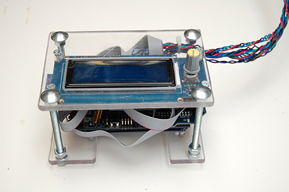 The Arduino Mega 2560 along with RAMPs 1.4 shield with LCD/SD board secured in a plastic housing