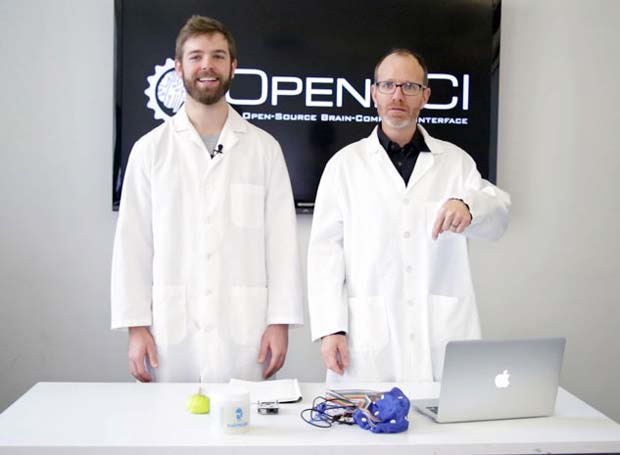 Russomanno (left) and Murphy demonstrate how to get started with OpenBCI.