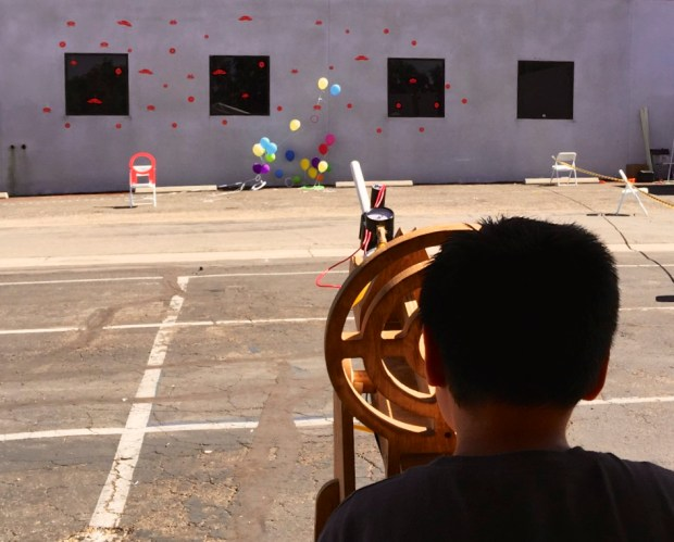 Paper rockets taking down space invaders and balloons (exhibit by 3Rs Robotics)