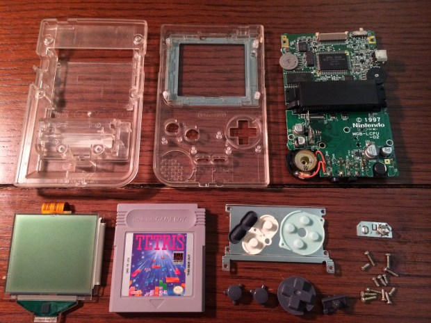 All of these parts, including the RPi and modified button pad fit nicely inside the Game Boy case.