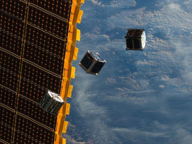 Student-built cubesats are released from the international space station's Kibo module. Credit: NASA
