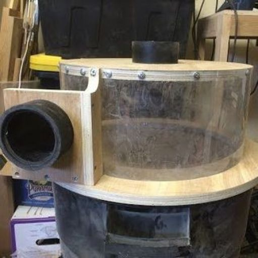 The handles are a dead giveaway as to what this cyclone dust separator is made from.