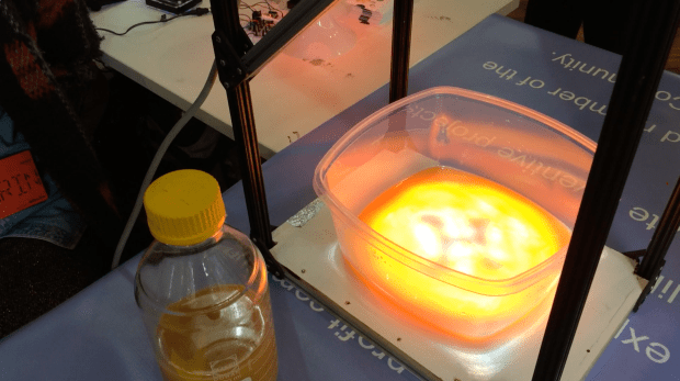 The JuicyPrint prototype—here the redder light indicates where the cellulose wouldn't be growing, and the bluer light is where the cellulose would. In this case the 3d bio-printer would be printing an 'H' symbol.
