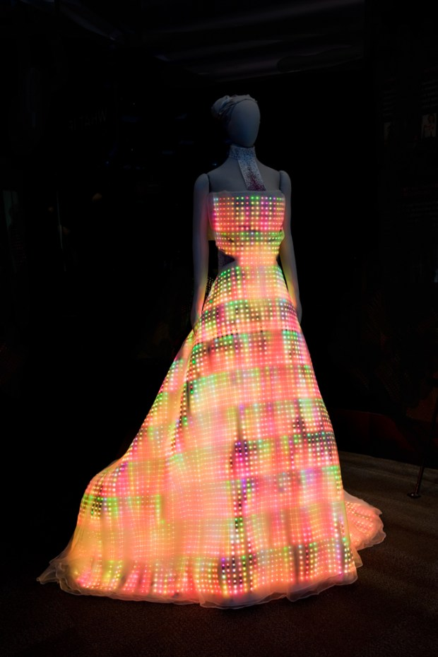 Commissioned for the Museum of Science and Industry in Chicago, a single picture doesn't do it justice. Preprogrammed light patterns cascade through the 24,000 hand-embroidered, full-color LEDs to create the largest wearable display in the world. Photographed by JB Spector