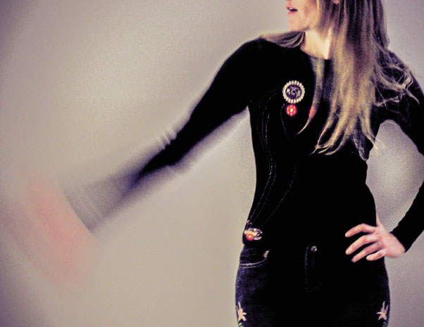 The accelerometer shirt by Leah Buechley uses accelerometer data to control the color of an RGB LED.