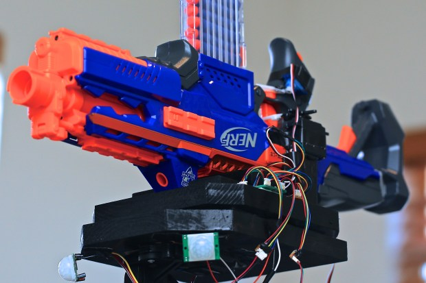 Jason_Mechatronic's Robotic Nerf Gun uses two motion sensors and servo motors to track targets while another pair of servo motors operates the trigger.