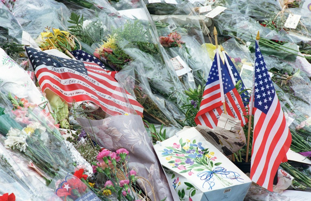 July 29, 1998: Flowers, flags and notes in memory of U.S. Capitol Police Detective John Gibson and Officer Jacob J. Chestnut lay on the East Front steps of the U.S. Capitol. Gibson and Chestnut were slain Friday in a shooting at the Document Room entrance. (Scott J. Ferrell /CQ Roll Call)