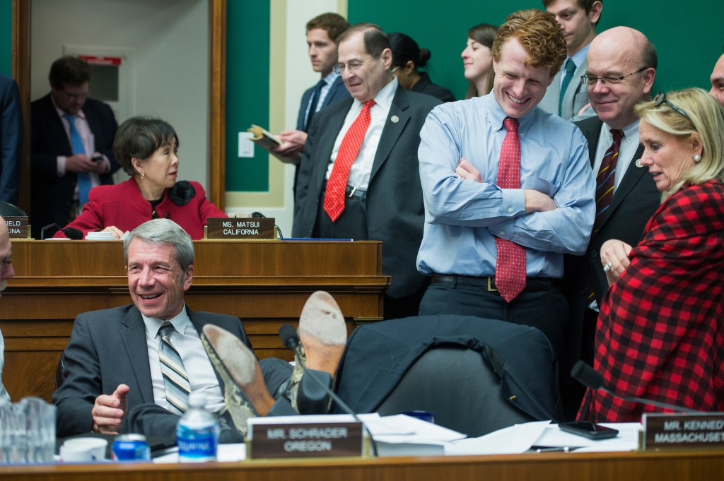 Rep. Kurt Schrader, D-Ore., kicks back as Reps. Joe Kennedy III, D-Mass., Jim McGovern, D-Mass., and Debbie Dingell, D-Mich., look on. The markup had just hit its 24-hour mark. (Tom Williams/CQ Roll Call)