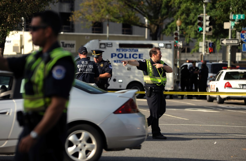 UNITED STATES - SEPTEMBER 17: U.S. Capitol Police congregate near 2nd and C Sts., SW, were members of the department fired on a man with the gun. The man survived and was taken to a local hospital. (Photo By Tom Williams/Roll Call via Getty Images)