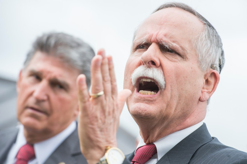UNITED STATES - APRIL 26: Rep. David McKinley, R-W.Va., right, and Sen. Joe Manchin, D-W.Va., attend a news conference at the House Triangle on April 26, 2017, with the United Mine Workers of America on the Miners Protection Act, which would address expiring health care and pension benefits. (Photo By Tom Williams/CQ Roll Call)