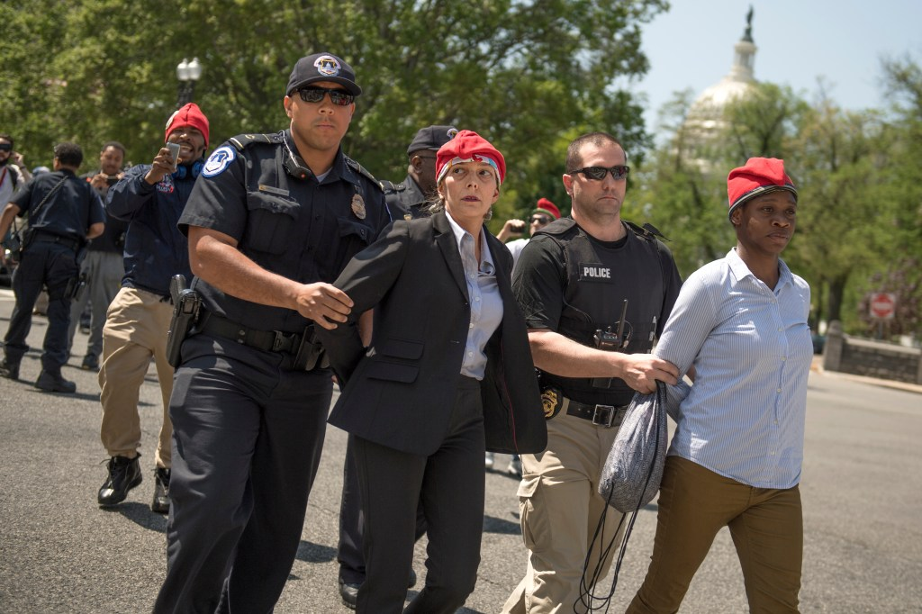 UNITED STATES - APRIL 20: RachelRamone Donlan, left, and Collette Cobb, are arrested after handing out joints during the 1st Annual Congressional #JointSession pot giveaway to credentialed Hill staff and the media on Constitution Ave. and First St. NE on April 20, 2017. The event was held by the DCMJ to call on Congress to reauthorize an amendment that prevents federal legal intervention in the District's marijuana laws. (Photo By Tom Williams/CQ Roll Call)