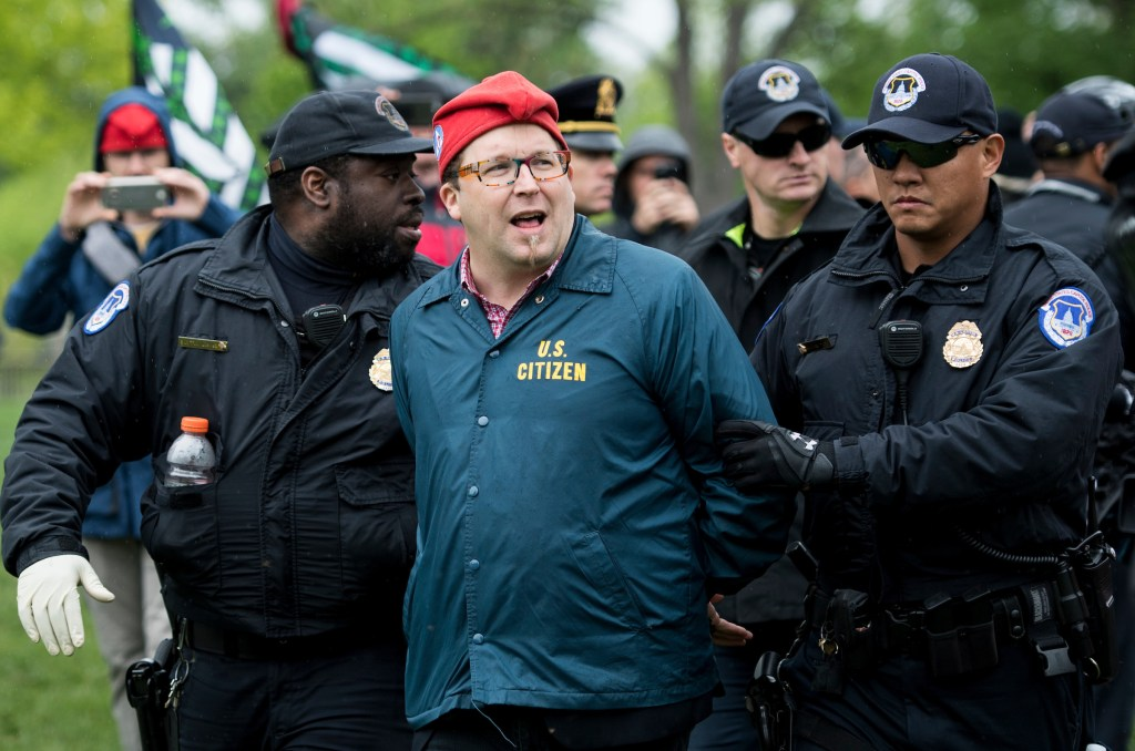 UNITED STATES - APRIL 24: Adam Eidinger, founder of DCMJ.org, is arrested by U.S. Capitol Police after he and several others smoked marijuana in front of the U.S. Capitol on Monday, April 24, 2017. The group held their protest to call on Congress to reschedule the drug classification of marijuana. (Photo By Bill Clark/CQ Roll Call)