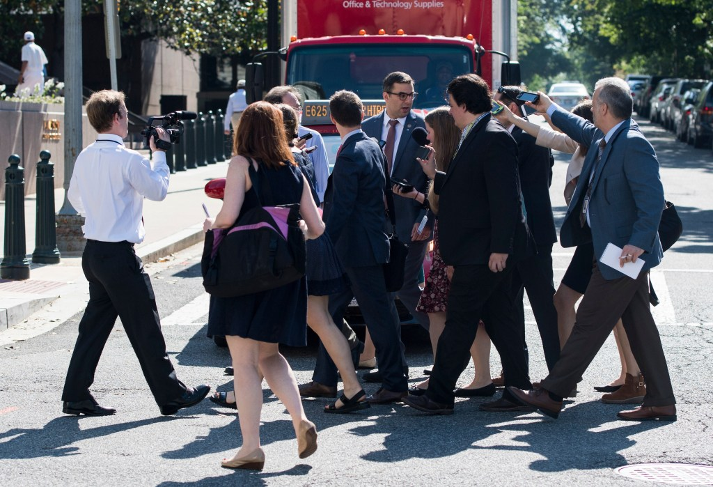 UNITED STATES - MAY 17: Reporters follow Rep. Justin Amash, R-Mich., across the street as he leaves the House Republican Conference meeting at the Capitol Hill Club in Washington on Wednesday, May 17, 2017. (Photo By Bill Clark/CQ Roll Call)