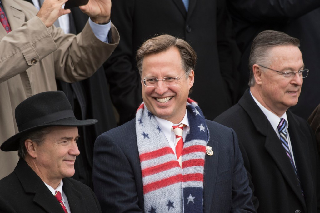 UNITED STATES - JANUARY 20: From left, Reps. Jody Hice, R-Ga., Dave Brat, R-Va., and Rod Blum, R-Iowa, are seen on the West Front of the Capitol before Donald J. Trump was sworn in as the 45th President of the United States, January 20, 2017. (Photo By Tom Williams/CQ Roll Call)