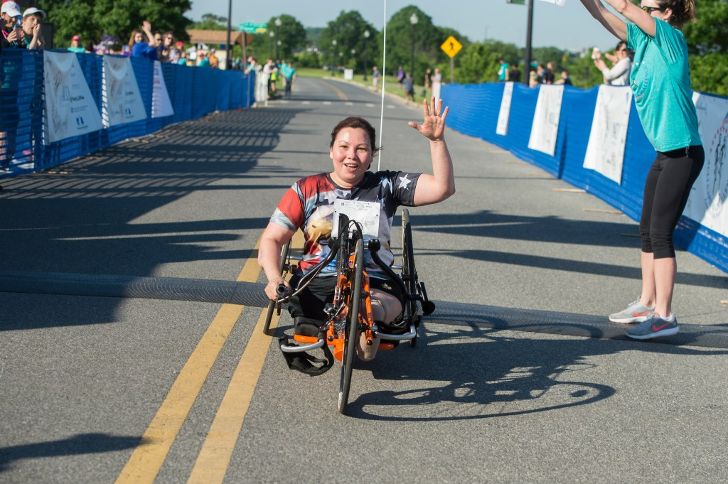 UNITED STATES - MAY 17: Sen. Tammy Duckworth, D-Ill., finishes the ACLI Capital Challenge 3 Mile Team Race in Anacostia Park, May 17, 2017. (Photo By Tom Williams/CQ Roll Call)