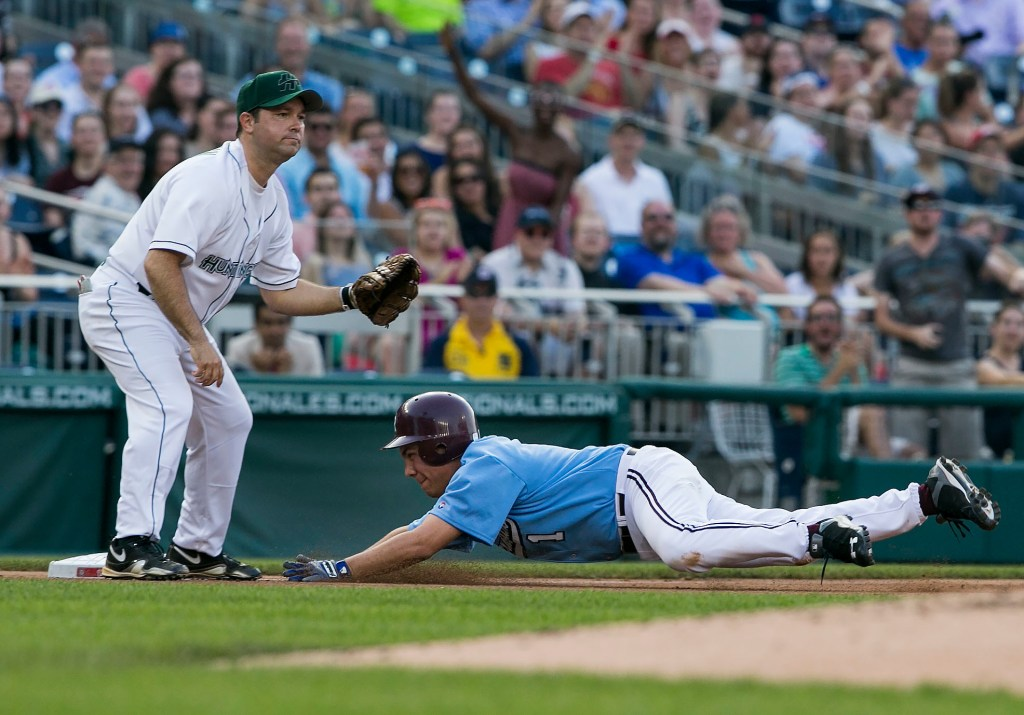 UNITED STATES - JUNE 11 - Rep. Pete Aguilar, D-Calif., slides safely into third base as Rep. Marlin Stutzman, R-Ind., waits for the ball during the 54th Annual Roll Call Congressional Baseball Game at Nationals Park in Washington on Thursday, June 11, 2015. The Democrats beat the Republicans 5-2. (Photo By Al Drago/CQ Roll Call)