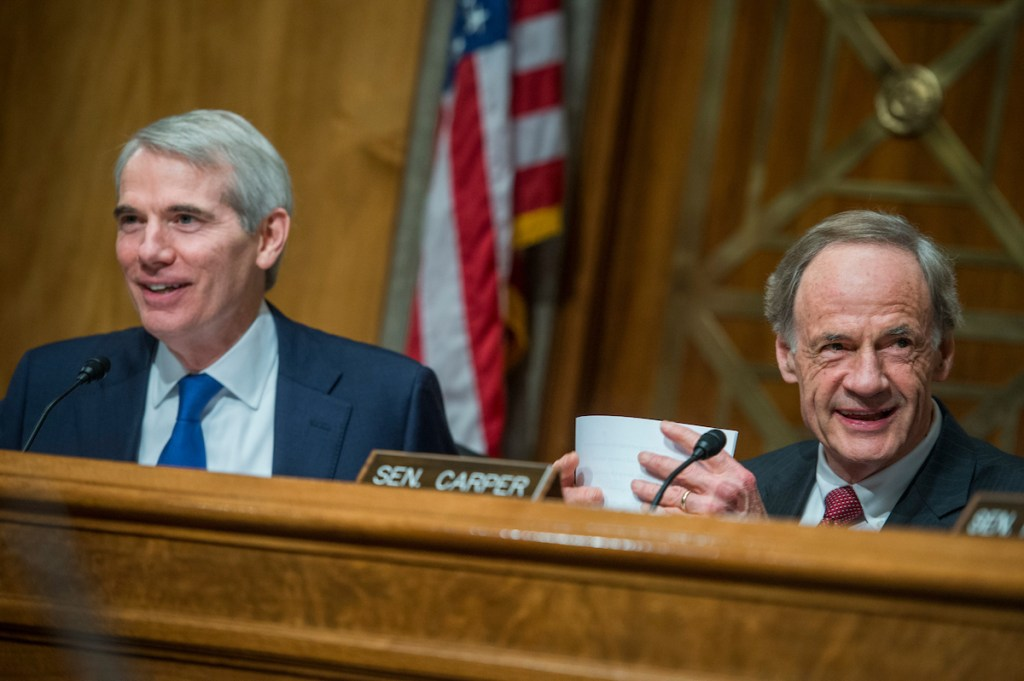 UNITED STATES - MAY 25: Chairman Rob Portman, R-Ohio, left, and Ranking Member Tom Carper, D-Del., conduct a Senate Committee on Homeland Security and Governmental Affairs Permanent Subcommittee on Investigations hearing in Dirksen Building titled