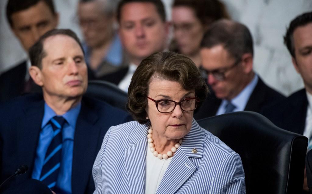 UNITED STATES - JUNE 8: Sen. Dianne Feinstein, D-Calif., and Sen. Ron Wyden, D-Ore., listen as Republicans members question former FBI Director James Comey during the Senate Select Intelligence Committee hearing on