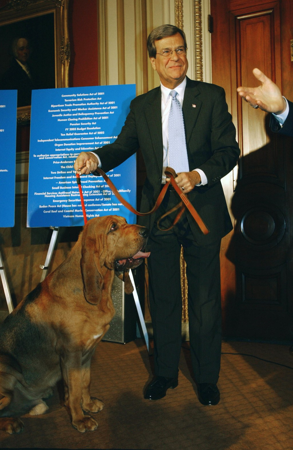 Senate Majority Leader Trent Lott, R-Miss., with bloodhounds at a news conference of GOP Senate leadership criticizing the Democratic leadership on its handling of the Senate agenda. As Lott and others entered the room with the dogs, they coaxed the dogs to