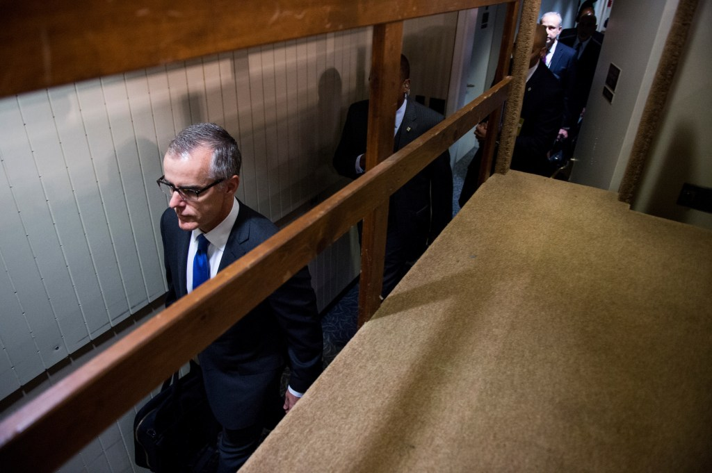 UNITED STATES - JUNE 7: Acting FBI Director Andrew McCabe walks through a back hallway as he arrives in the Hart Senate Office Building to testify during the Senate Select Intelligence Committee hearing on Wednesday, June 7, 2017. (Photo By Bill Clark/CQ Roll Call)