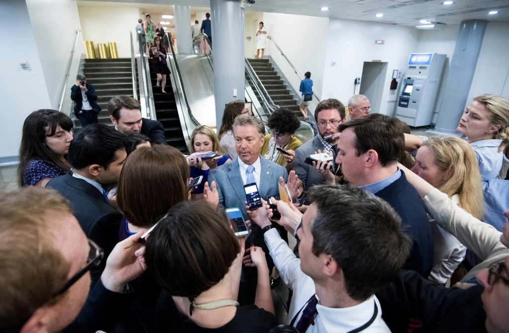 Sen. Rand Paul, R-Ky., speaks with reporters as he leaves the Capitol following a vote on Monday. (Bill Clark/CQ Roll Call)