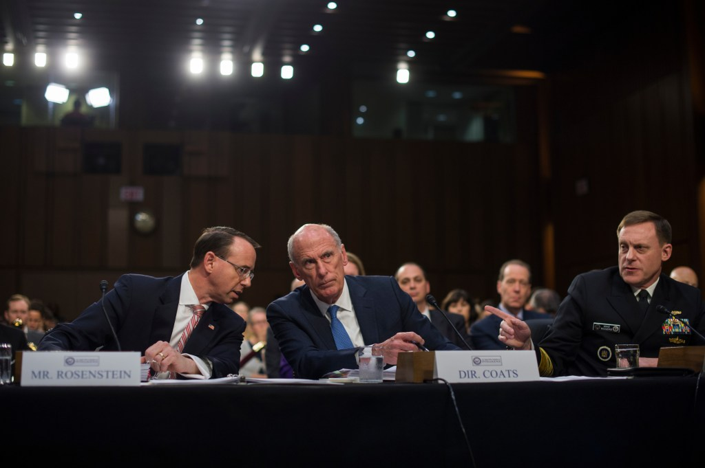 UNITED STATES - JUNE 7: From left, Deputy Attorney General Rod Rosenstein, Director of National Intelligence Dan Coats, and NSA Director Admiral Michael Rogers, appear before a Senate Select Intelligence Committee hearing in Hart Building on June 7, 2017. (Photo By Tom Williams/CQ Roll Call)