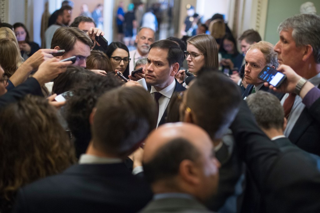 UNITED STATES - JUNE 27: Sen. Marco Rubio, R-Fla., talks with the media after the Senate Policy luncheon in the Capitol on June 27, 2017. Senate Majority Leader Mitch McConnell, R-Ky., told senators there would be no vote on health care this week. (Photo By Tom Williams/CQ Roll Call)