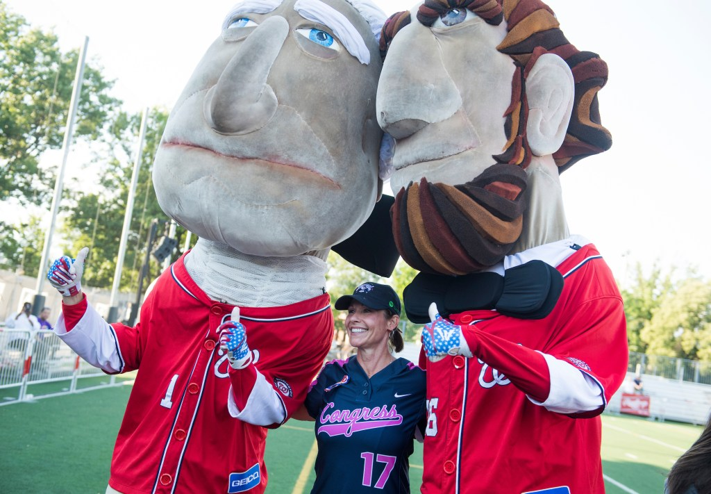 UNITED STATES - JUNE 21: Rep. Cheri Bustos, R-Ill., poses with the Racing Presidents before the Congressional Women's Softball game that pits Congresswomen against female journalists at Watkins Recreation Center on Capitol Hill, June 21, 2017. The game benefits the Young Survival Coalition that helps young women with breast cancer. The press team prevailed 2-1. (Photo By Tom Williams/CQ Roll Call)