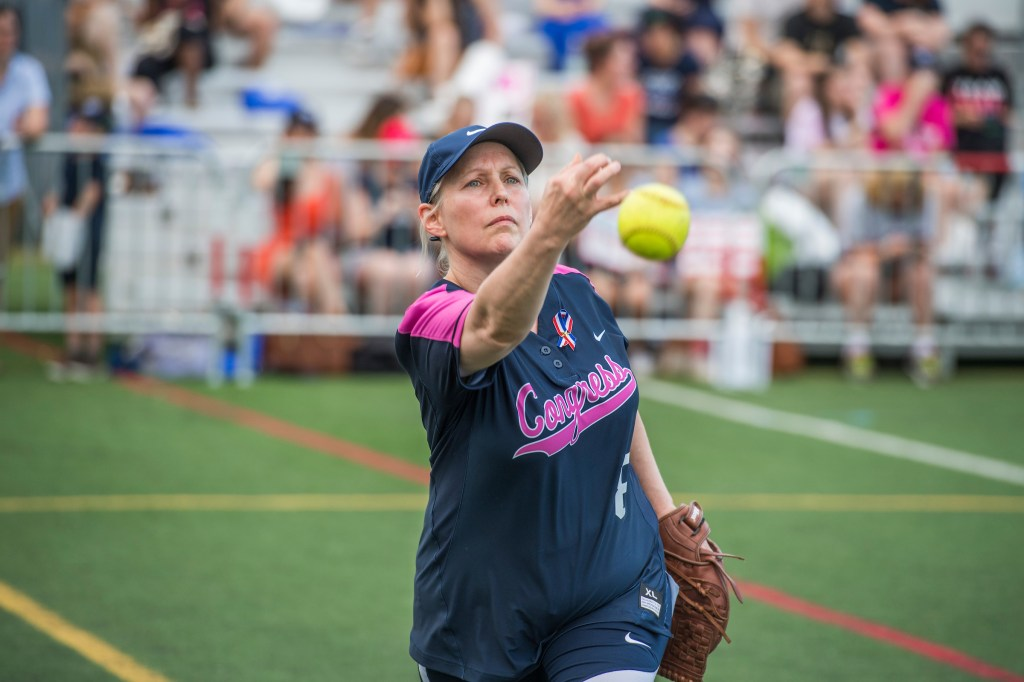 UNITED STATES - JUNE 21: Sen. Kirsten Gillibrand, D-N.Y., warms up before the Congressional Women's Softball game that pits Congresswomen against female journalists at Watkins Recreation Center on Capitol Hill, June 21, 2017. The game benefits the Young Survival Coalition that helps young women with breast cancer. The press team prevailed 2-1. (Photo By Tom Williams/CQ Roll Call)