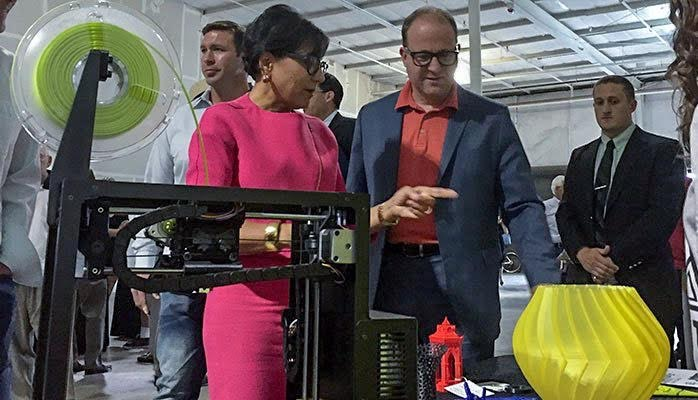 For last year's Startup Day, Polis checked out a 3D printer with then-Commerce Secretary Penny Pritzker. (Courtesy Polis' office)