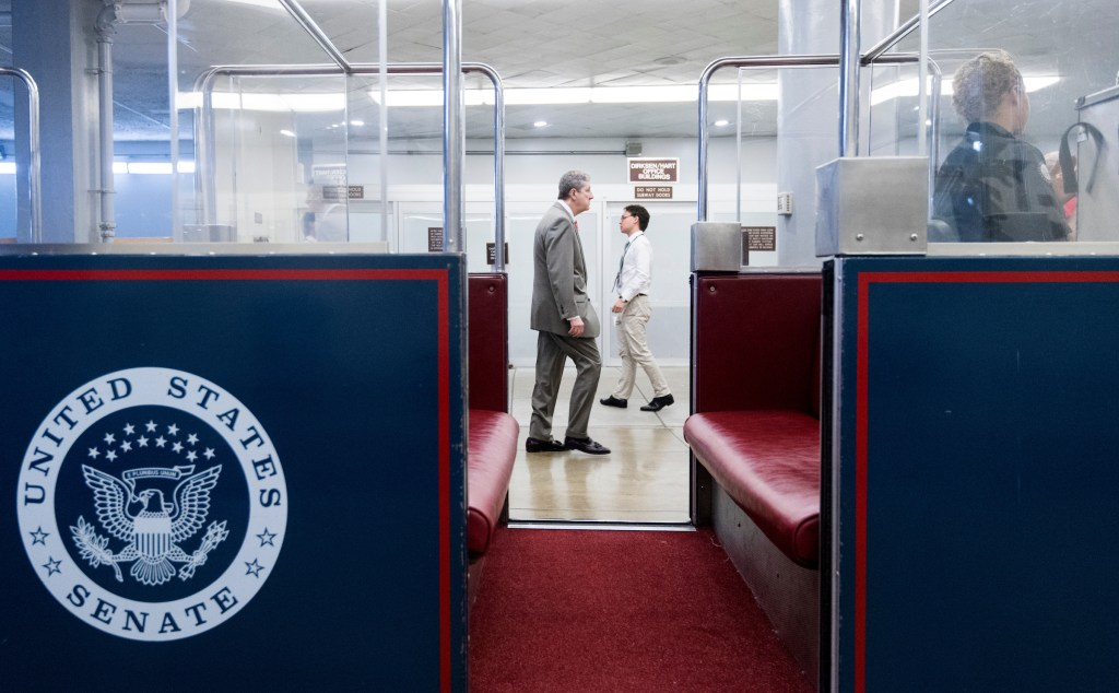 Sen. John Kennedy, R-La., walks through the Senate subway as he arrives in the Capitol for a vote on Wednesday. (Bill Clark/CQ Roll Call)