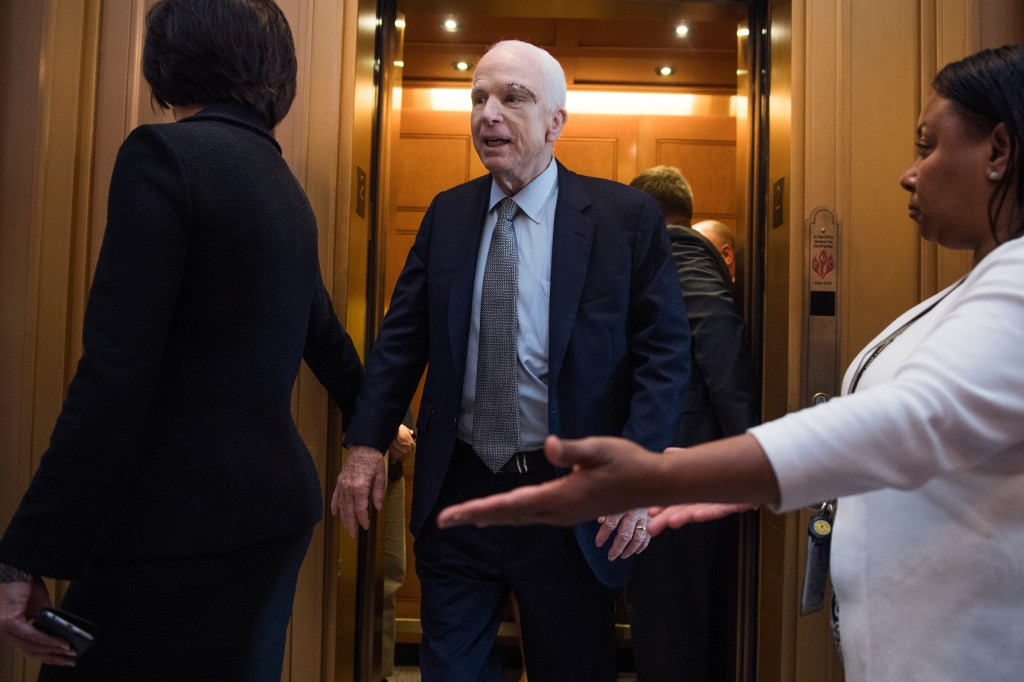 Sen. John McCain, R-Ariz., arrives in the Capitol to cast a vote to start debate on the Senate's healthcare bill on July 25, 2017. (Tom Williams/CQ Roll Call)
