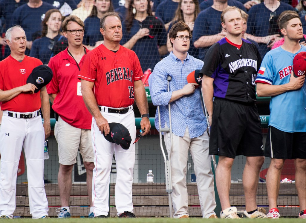 UNITED STATES - JUNE 15: Congressional staffer Zack Barth, center, injured at the baseball practice shooting the day before, stands during the annual Congressional Baseball Game at Nationals Park in Washington on Thursday, June 15, 2017. (Photo By Bill Clark/CQ Roll Call)