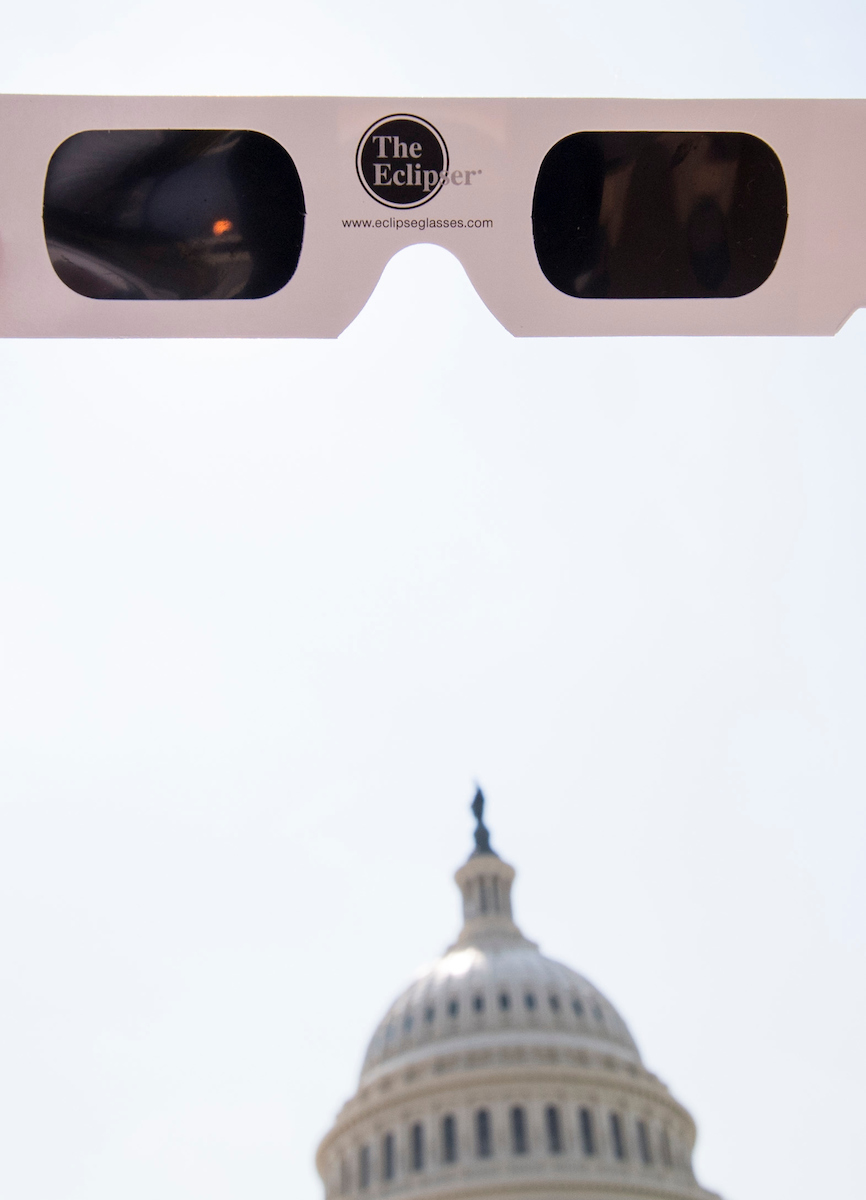 UNITED STATES - AUGUST 21: The partial solar eclipse is seen through eclipse glasses in front of the U.S. Capitol on Monday, Aug. 21, 2017. (Photo By Bill Clark/CQ Roll Call)